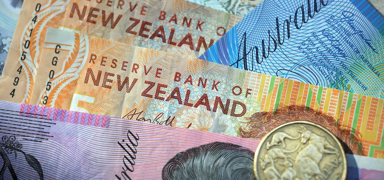 Kiwi slumps on dismal NZ data, Aussie stands still