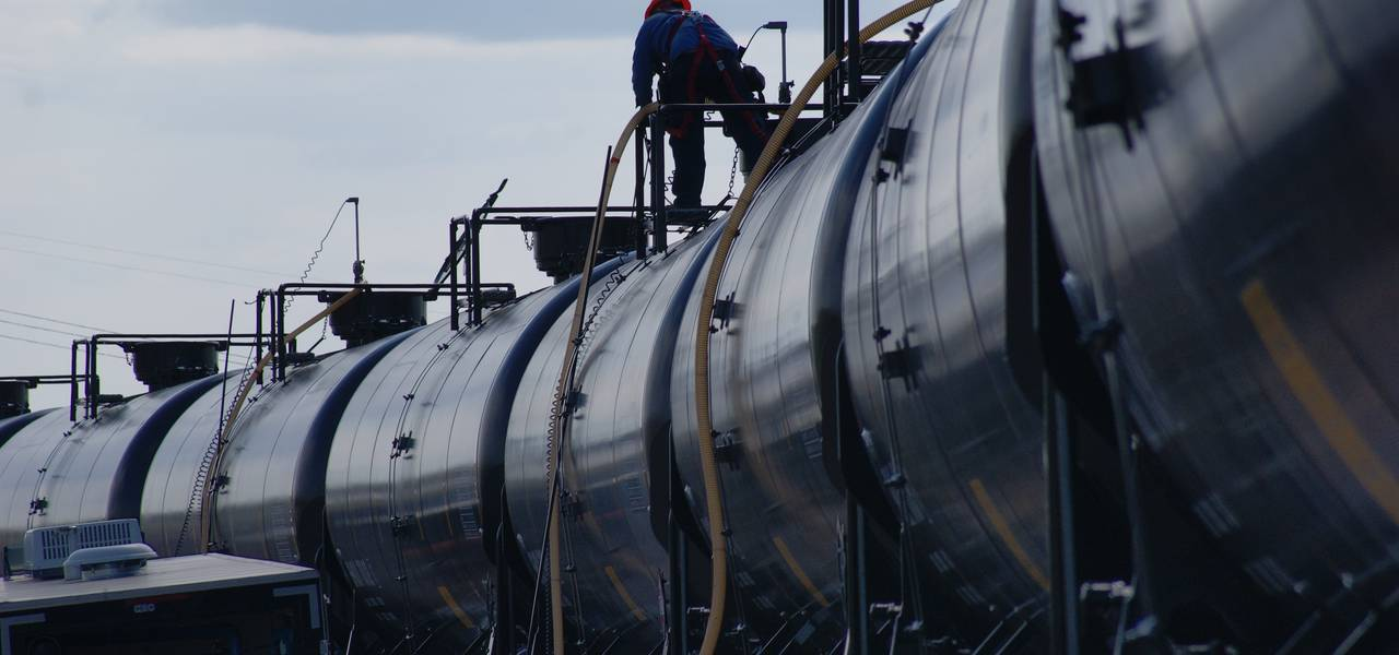 Crude prices dip on expected climb in US output