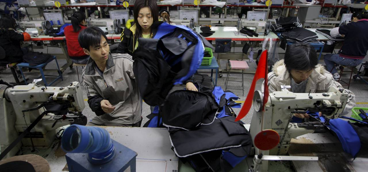 China's manufacturing surge picks up moderately in March