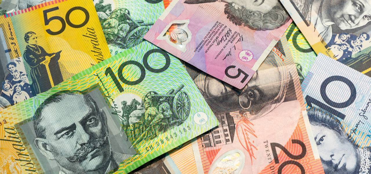 Australian dollar tacks on