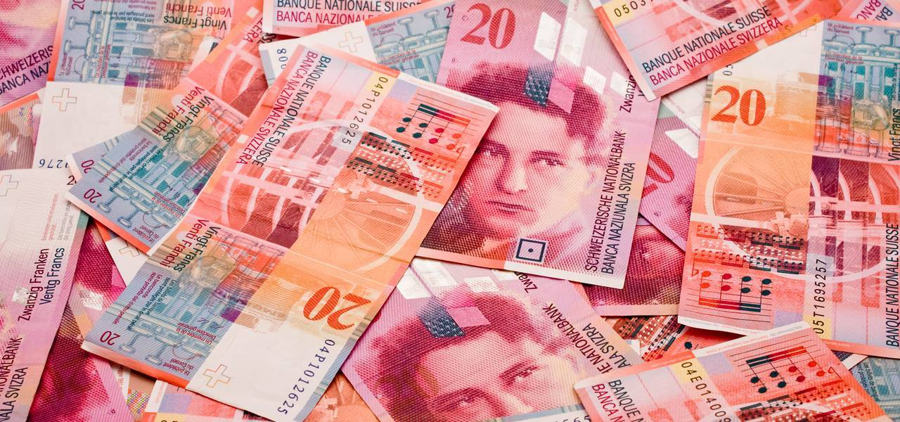 Swiss franc leaps in risk-off trade