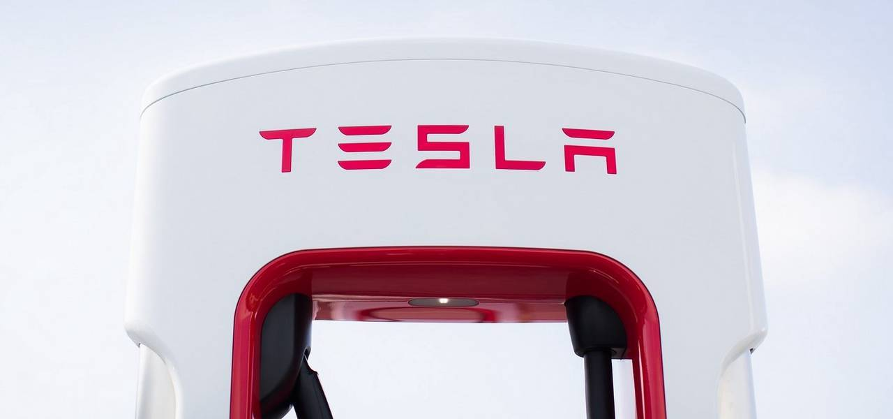Tesla leads Nasdaq to record highs